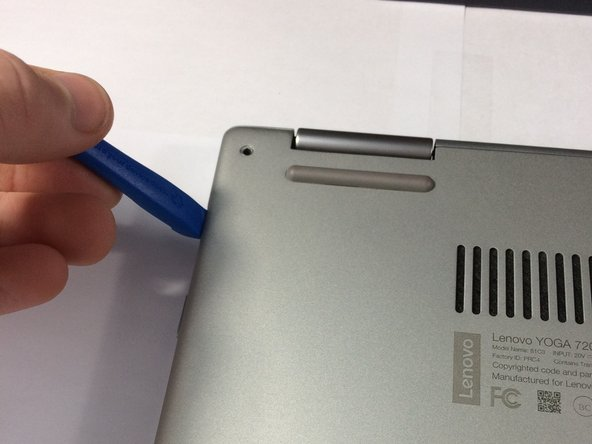 Make sure you are prying on the cover itself, not the metal shield around the USB port.