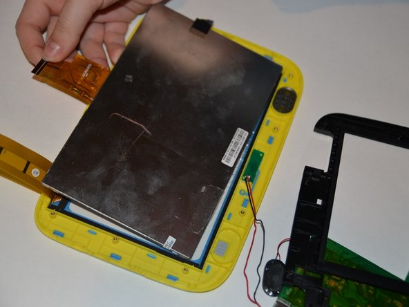 Lift up the logic board and black plastic so that they are no longer covering the screen