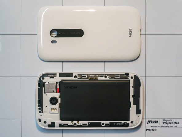 Remove the back cover, the battery, and the sim card with its bracket.