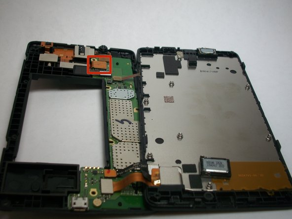 With tweezers, gently undo the motherboard connector for the vibrator, headphone jack and camera flash assembly.
