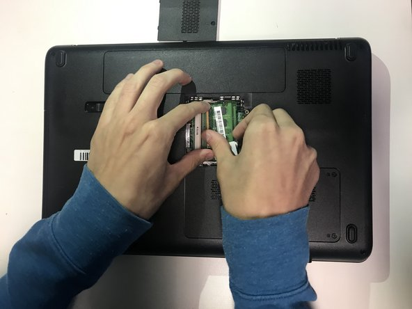 Use your fingers to push the retention clips away from the RAM sticks, and carefully pull out the old RAM.