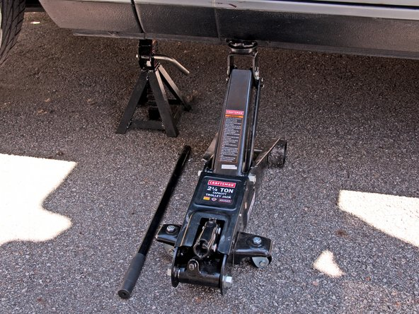 Image 3/3: To be safe, jack stands should never be the only thing holding your car up. Always leave the jack up against the jack point in case the jack stand fails.
