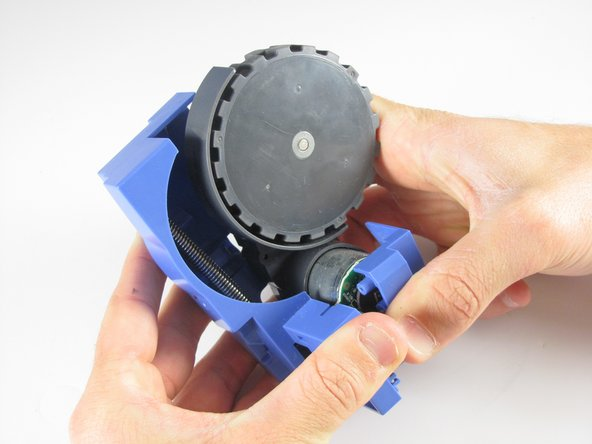 Pull apart the blue holder to completely remove the wheel
