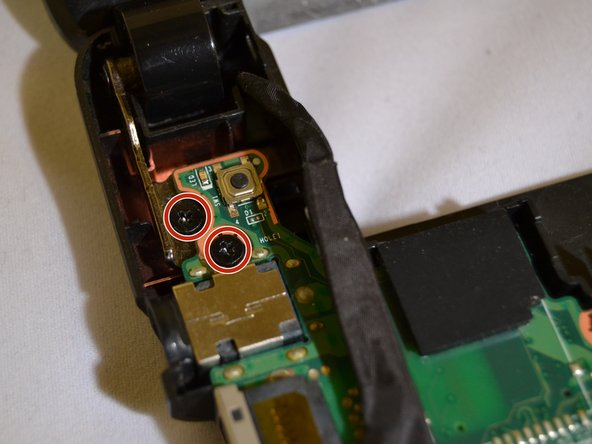 Using a Phillips #00 screwdriver, remove the screws on the hinges holding the laptop screen and the keyboard together: