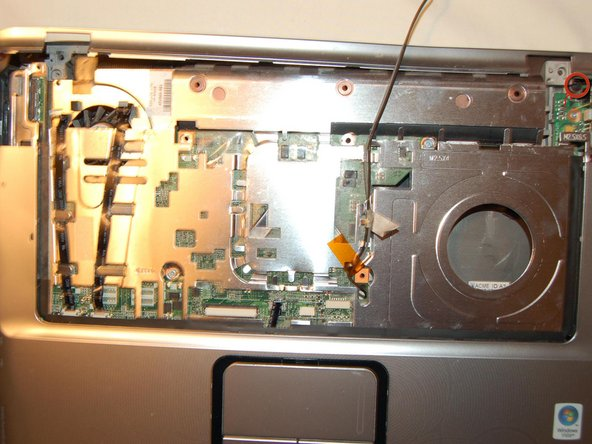 Remove the screw on the right, and remove the back bezel.