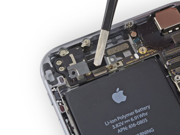 Remove the upper cable bracket from the iPhone.