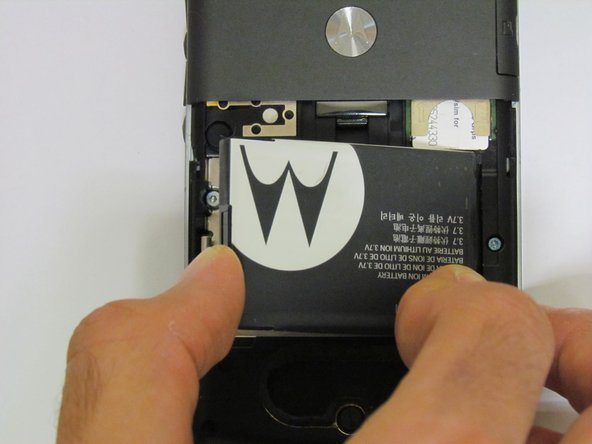 Image 2/2: When reinserting the battery, make sure the contacts in the battery are lined up with the contacts in the phone.