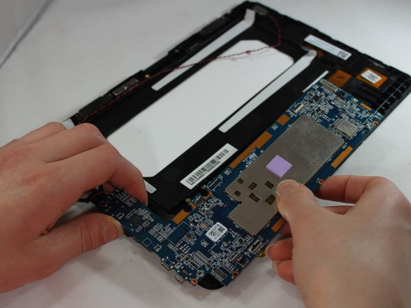 Gently lift and remove the motherboard and speakers from tablet.