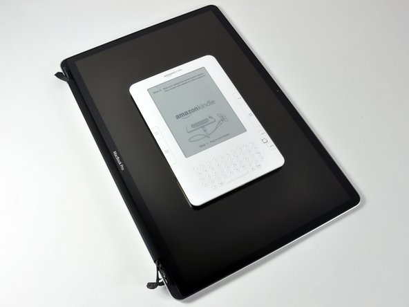 Kindle size compared to MacBook Pro 17