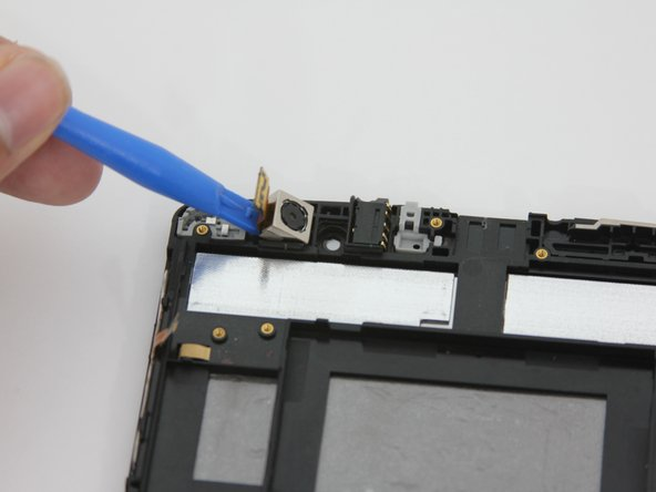 After prying ribbon connector, the rear-facing camera should be ready for removal.