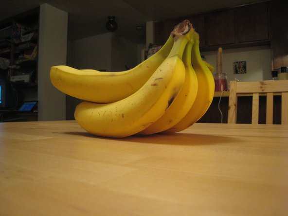 Take one banana from the bunch.