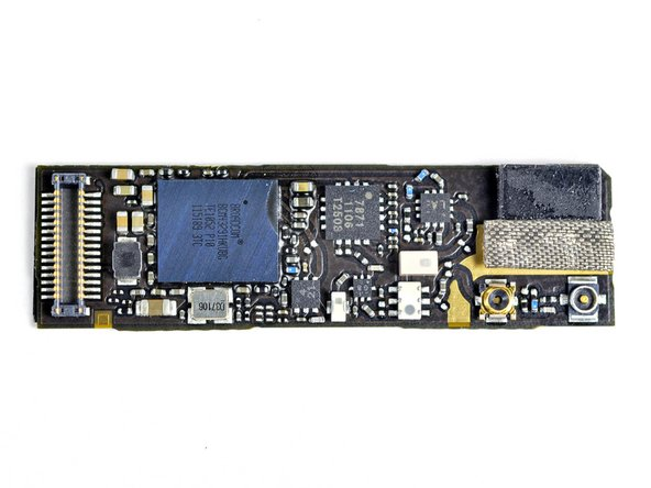 The Wi-Fi board; powered by another Broadcom chip, a BCM43291HKUBC.  Broadcom has made this Wi-Fi/Bluetooth/FM tuner combo chip a ubiquitous part for smartphones - lots of design wins.