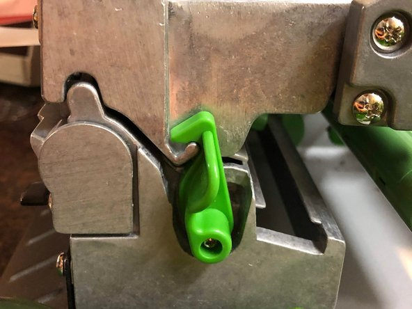 "Assess where the problem is within the machine. Press the green button that says ""push"" to release the end of the armband that is clamped in the machine."