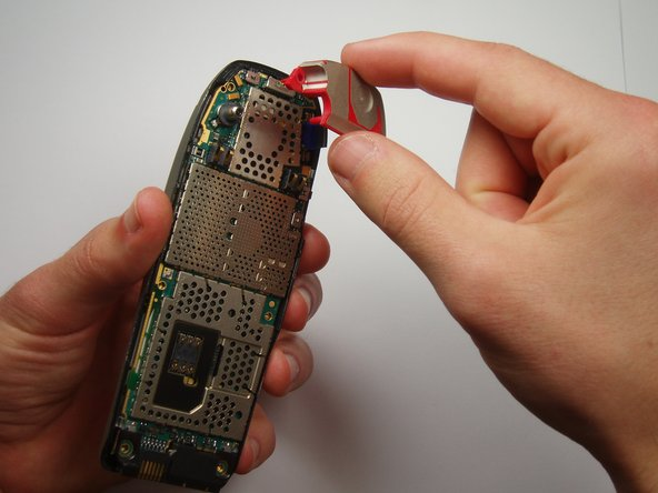Image 2/2: Carefully lift off the antenna from the circuit board.