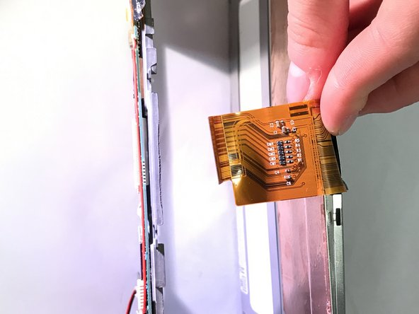 Taking the tweezers, remove the ribbon cable from the control panel.