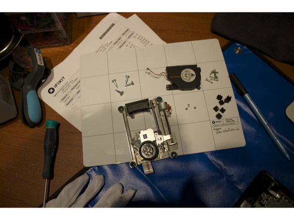 Remove the four screws and place the optical drive with it's screws on your project mat.