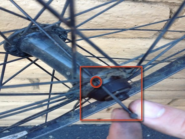 Maneuver the spoke so that it is perpendicular and slide the spoke out.