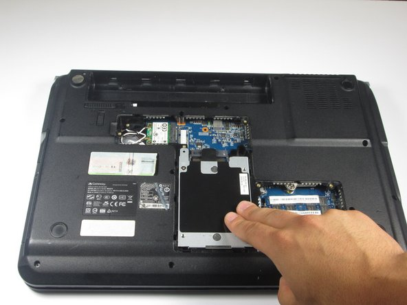 Lift the hard drive to a 90 degree angle and out of its slot.