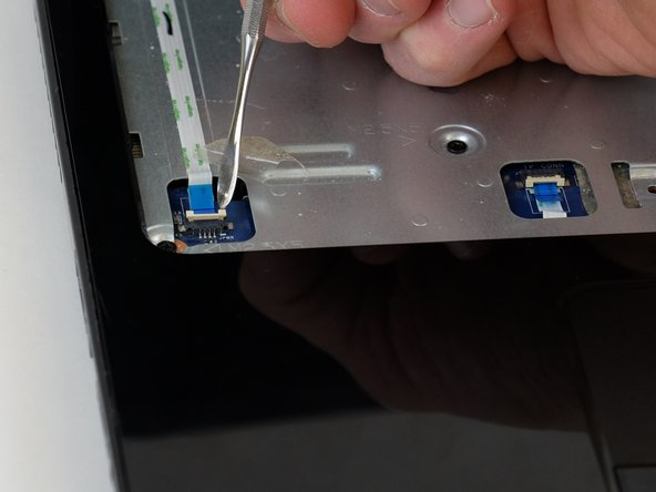 Disconnect the power button ribbon cable by lifting the connector.