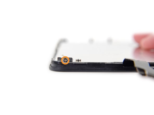 One at bottom of the display assembly near the home button opening