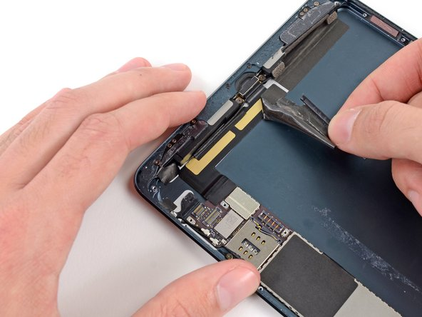 Continue peeling the tape, and remove it from the iPad.