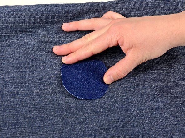 Lay your cut patch over the hole and position it where you want it.
