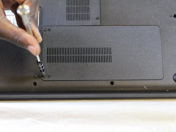 Loosen the two M2.5x3 mm Phillips screws securing the hard drive cover.