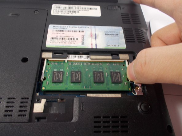 Gently push the levers on each side of the stick of RAM away from each other until the RAM springs into a 45° angle.