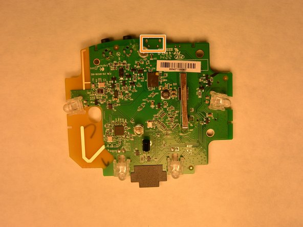 Image 3/3: Using a soldering iron, remove the solder and the charging port. Install a new charging port and solder.
