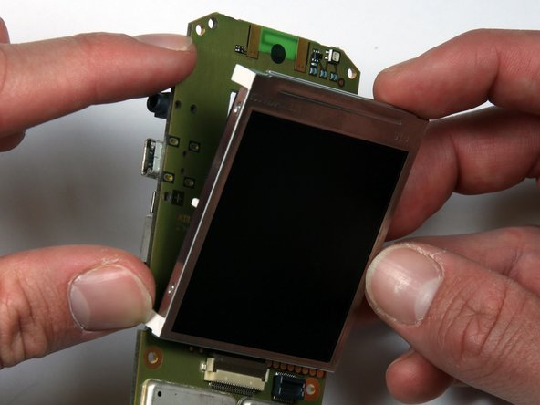 Image 3/3: The screen can now be removed from the motherboard.
