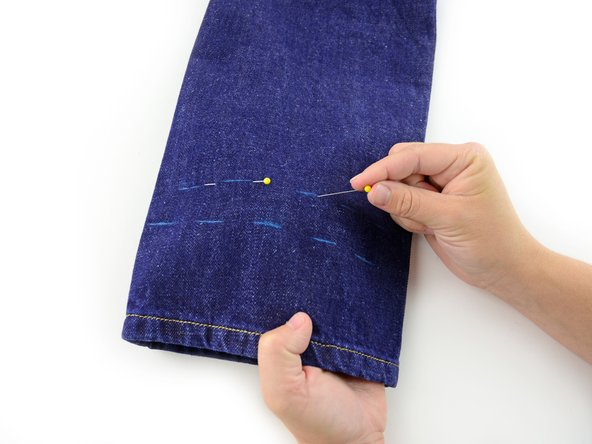 Be sure to only catch one layer of the jeans, as you don't want to pin the pant leg shut!