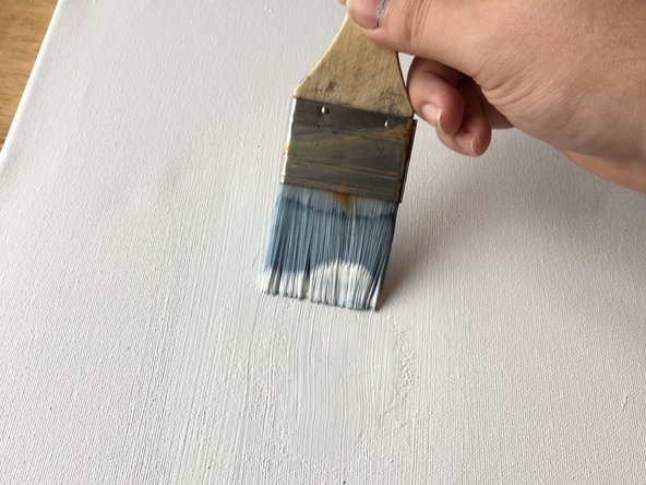 After the sanding process is finished, we apply a final layer of Acrylic Gesso. You can apply it with a small or medium brush. Let it dry for 1 hour.