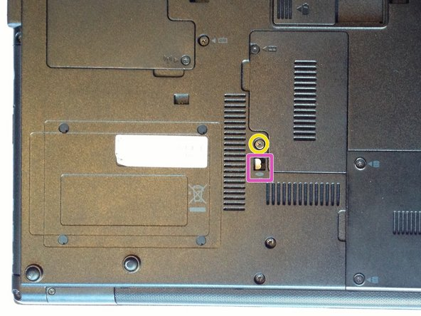 With the bottom of the laptop facing up and the front toward you locate and loosen the M2.5×9.0 captive screw holding the optical drive into the laptop.