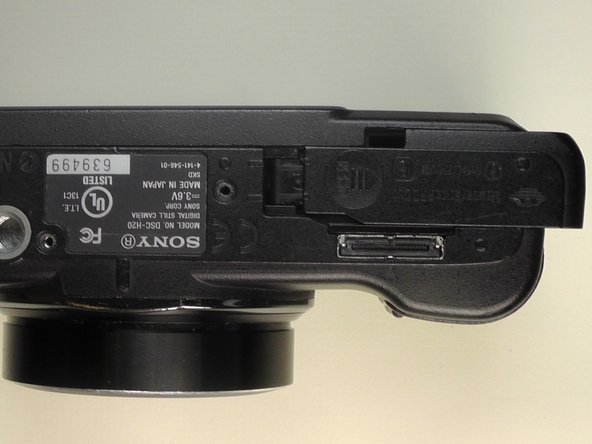 Place the camera upside down with the battery port positioned upward.