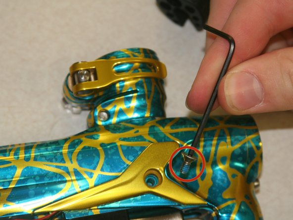 Image 2/3: Pull off eye covers. (Located on both sides of the paintball marker.)