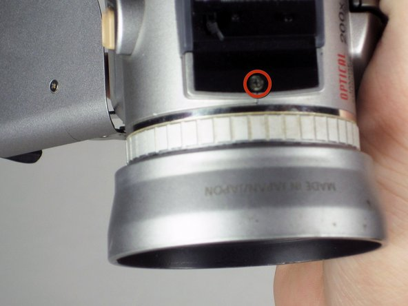 Image 1/1: Open the pop up flash on the top of the camcorder.