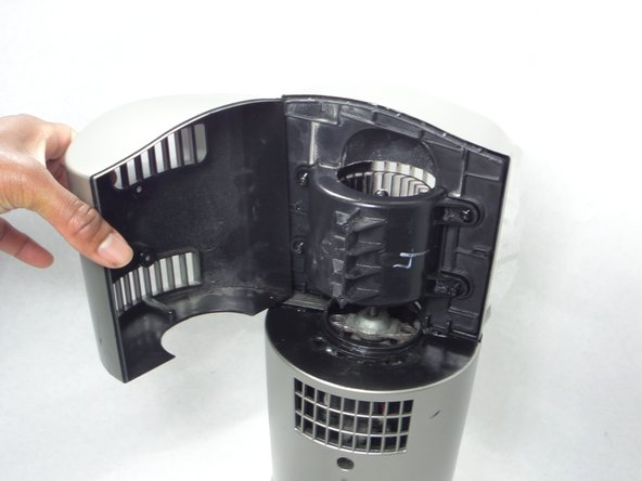 Remove the top plastic portion of the fan