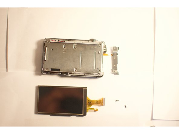 Gently slide the cable out of the lock; the LCD screen is now ready to be removed.