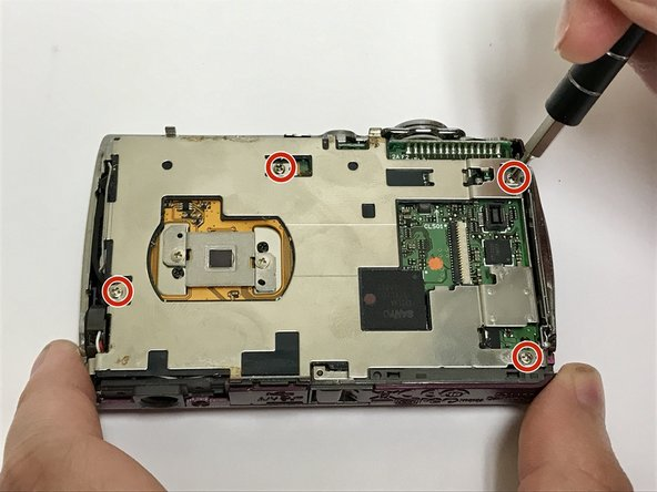 Using a #000 Phillips screwdriver, remove the four 4-mm screws from the metal plate.