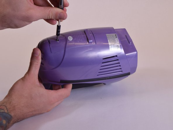 Locate and remove the 7.5mm Philips screw holding the battery cover in place on bottom of the vacuum.