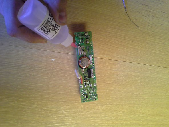 Using more flux, and some new solder, solder the new battery onto the board.