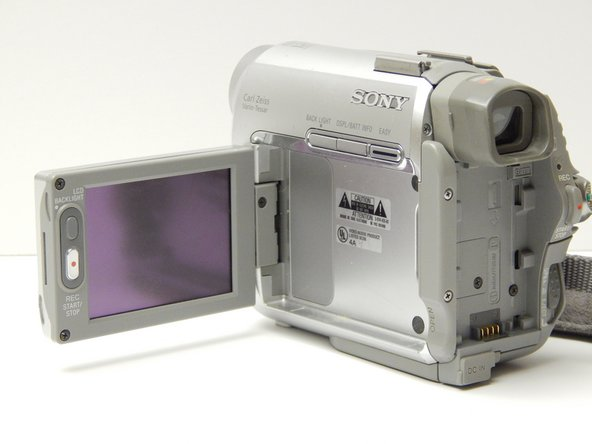 Image 1/2: Bring the LCD screen to the fully open position.