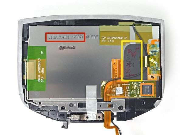 Image 2/2: With the casing out of the way, we find a few antennas, a single IC, and a display cable hanging out on the back of the display.