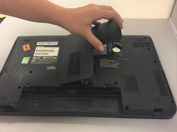 Remove the middle plastic cover to expose the hard drive.