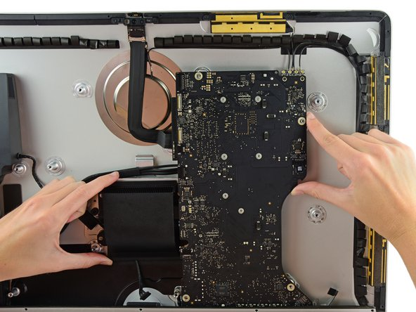 Image 1/3: Lift the logic board straight up and out of the iMac.