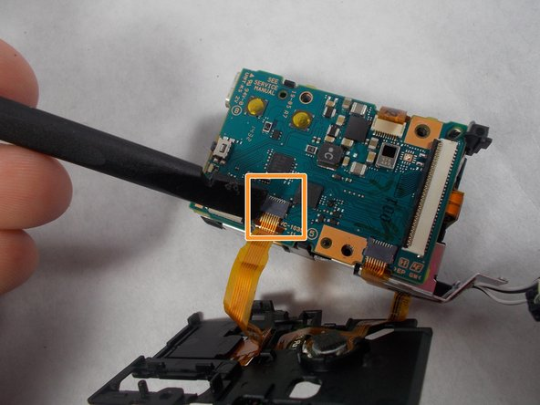 Image 3/3: Pull the plastic up gently, it will be connected by cables on the bottom.