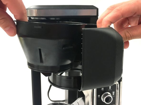 Remove brew basket from swinging basket holder