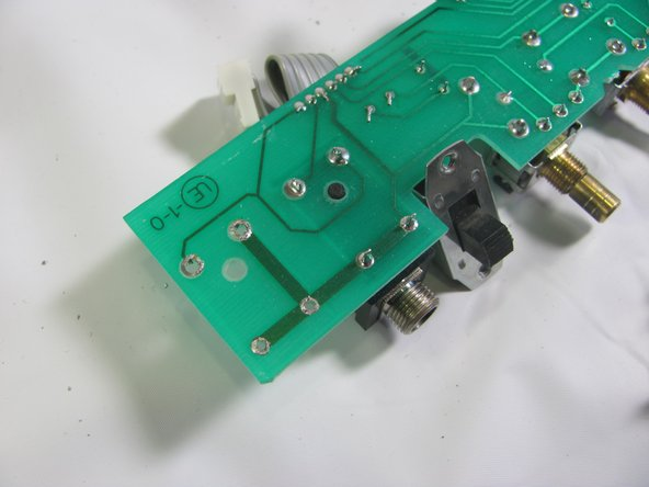 Remove the jack once the joints are broken and clean out excess solder