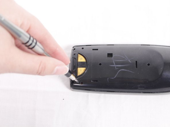 Locate the three 50mm screws on the back of the remote and remove them using the Phillips #0 screwdriver.