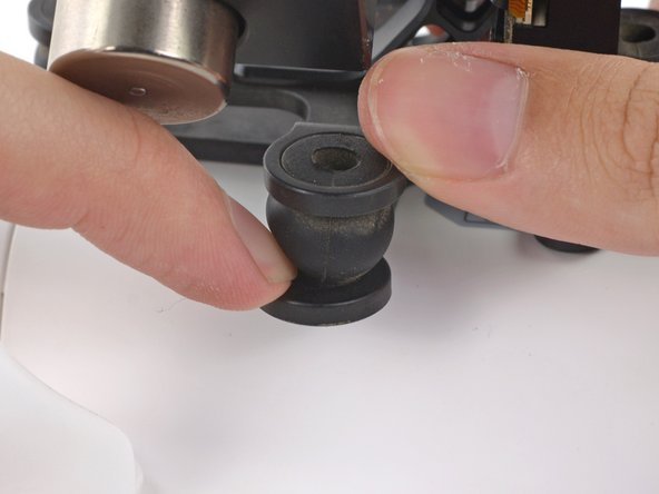 Image 3/3: Pinch two sides of the rubber dampers and press it into the mounting bracket holes.